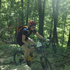 Riders work on their skills over handbuilt rock gardens on the mountain bike trails at Brown County State Park.