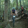 Riders learn how to clearn a log crossing during the 2007 Midwest Women's Mountain Bike Clinic.