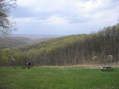 On a beautiful early Spring day, this mountain biker nears the top of the Hesitation Point Trail in Brown County State Park near Nashville, IN.