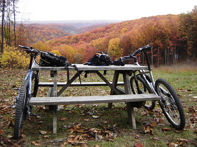 The fall leaves are ablaze with color on the mountain bike trails at Hesitation Point in Brown County State Park near Nashville, Indiana.