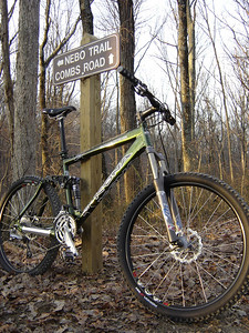 A mountain bike leans against the signpost while the riders take a break on this winter morning ride on the Nebo Ridge Trail in the Hoosier National Forest near Story, IN.