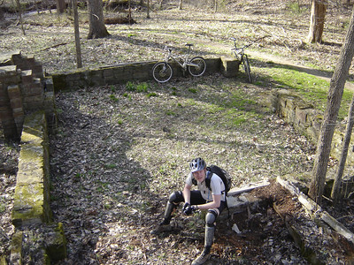 This mountain biker sits a spell at an old building foundation on the Aynes Loop in Brown County State Park.