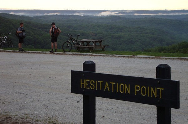 Two riders stop at Hesitation Point for a break as the smoke settles into the valleys.  Click to view photo album.