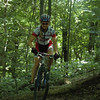 A rider practices on a log at the 2007 Midwest Women's Mountain Bike Clinic.